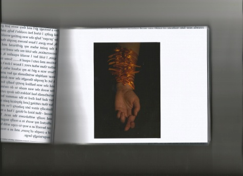 The book uses acetate through out, the viewer can choose to look through the writing or at the image alone