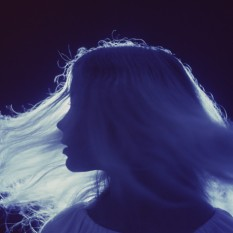 dennis-hallinan-silhouetted-portrait-of-woman-with-flowing-hair